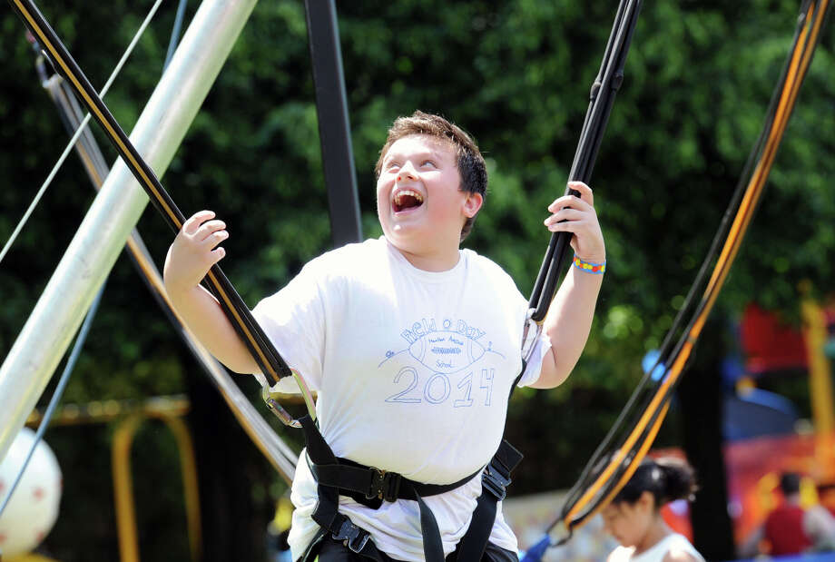 Matthew Niemynski, 10, of Greenwich, enjoys a ride during the  Spring-A-Palooza event at Hamilton Avenue School in the Chickahominy section of Greenwich, Conn., Staurday morning, June 7, 2014. Photo: Bob Luckey / Greenwich Time