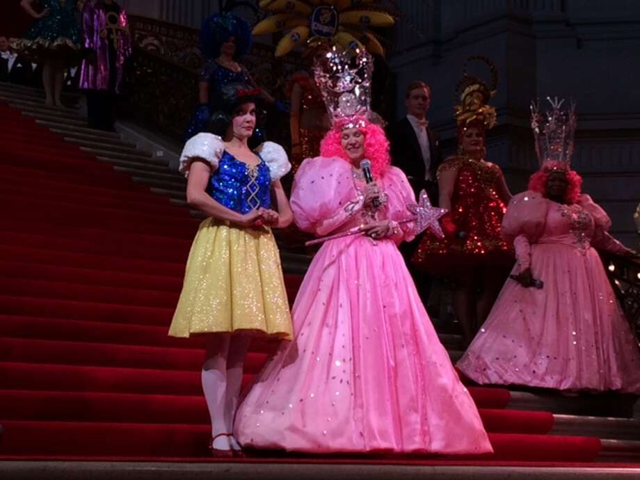 Renee Lubin (far right) looks on as Dede Wilsey as Glinda,  banters with Rena Wilson, Snow White Photo: Leah Garchik