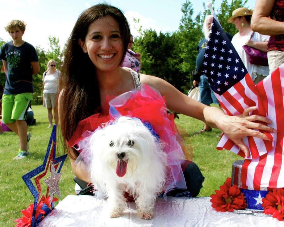 Dogs and their humans strutted what their momma's gave them during a Pooch Parade at Phil Hardberger Park as part of National Trails Day. Photo: 0320412472, By DeAnne Cuellar, For MySA.com