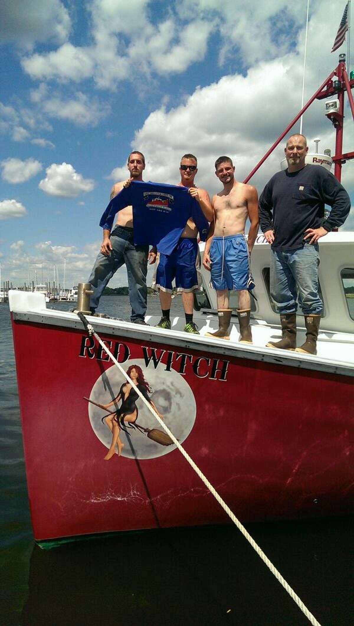 The captain and crew of the Red Witch, one of three boats who came to aid of boat fire in Stratford. The Red Witch is a clam boat, similar to the one that cought fire in the Housatonic River on Saturday, June 7, 2014. Three people on board were rescued, but one of the men received three-degree burns.