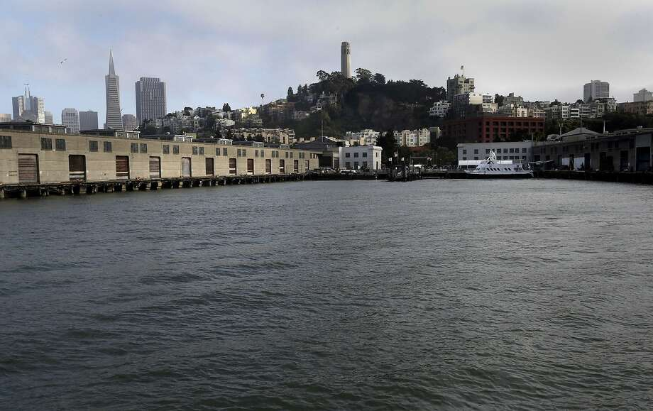 A civil grand jury report raises concerns that the city is not prepared to deal with rising sea levels and their effect on waterfront development. Photo: Michael Macor, The Chronicle