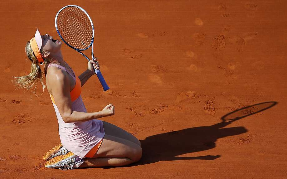 Maria Sharapova reacts after securing the French Open title with a win over Simona Halep. Photo: David Vincent, Associated Press