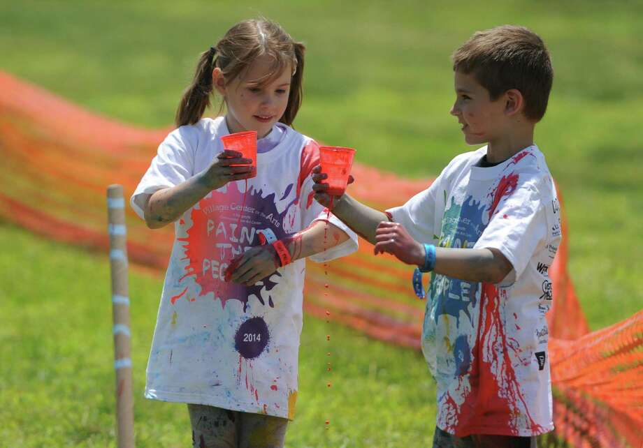 Photos from Paint the People 2014 at the John Pettibone School in New Milford, Conn. Saturday, June 7, 2014.  Paint the People, sponsored by the Village Center for the Arts in New Milford, featured many fun paint activities for kids including splatter battles, a paint-stacle course, a public mural, paint twister, spin art, an art show and paint-along demonstrations. Photo: Tyler Sizemore / The News-Times