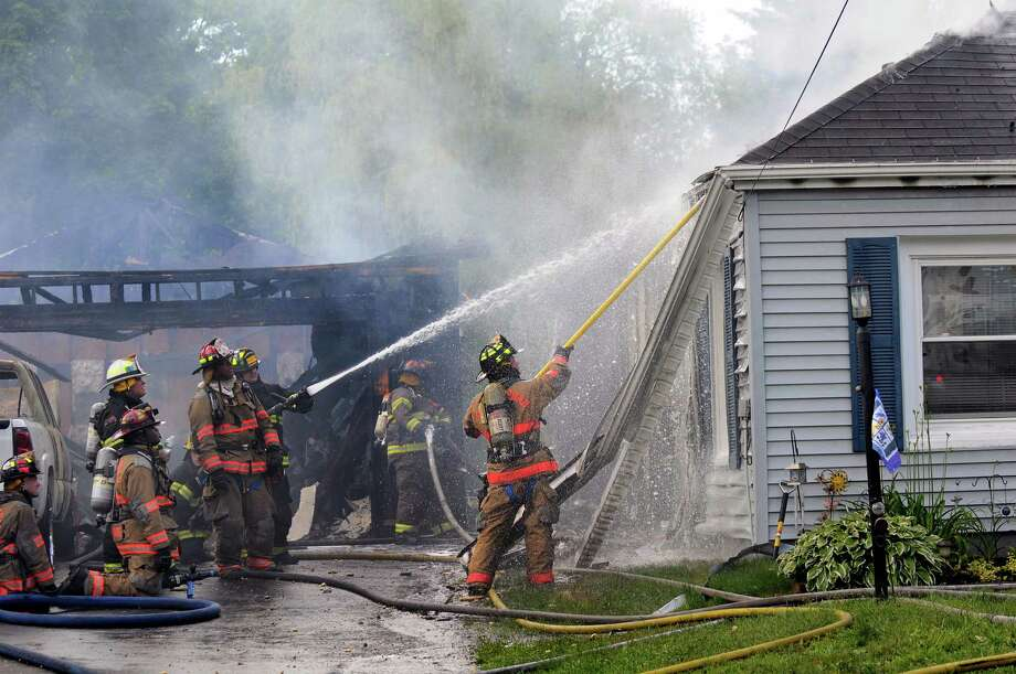 Firefighters work to contain a fire at 217 Osborne Rd. on Saturday, June 7, 2014, in Colonie, N.Y. (Cindy Schultz / Times Union) Photo: Cindy Schultz