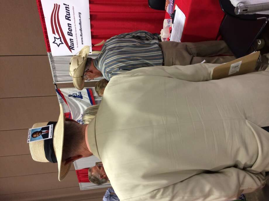 Bruce Woodcock, 69, financial adviser, San Leon, is pictured in his hat at the 2014 Texas GOP convention in Fort Worth.