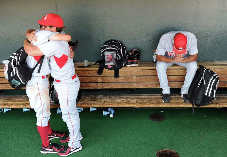 Houston's Daniel Smith, second from left, hugs teammate Jared Robinson as Frankie Ratcliff, right, collects his thoughts after the Cougars' 4-0 defeat to the Texas Longhorns in an NCAA baseball super regional game, Saturday, June 7, 2014, at UFCU Disch-Falk Field in Austin. Photo: Eric Christian Smith, For The Chronicle