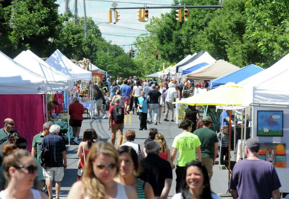 A teeming Lark Street during the annual Art on Lark on Saturday June 7, 2014 in Albany, N.Y. (Michael P. Farrell/Times Union) Photo: Michael P. Farrell / 00027265A
