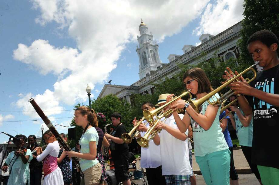 The Central Park Jazz Mob performs during the Schenectady Children's Art Festival on Satuday June 7, 2014 in Schenectady, N.Y. The fesitval was sponsored  by the ElectriCity Arts District and a wide number of individuals who commit to providing free arts and crafts with some learning thrown in, to Schenectadya€™s children. Michael P. Farrell/Times Union) Photo: Michael P. Farrell / 00027174A