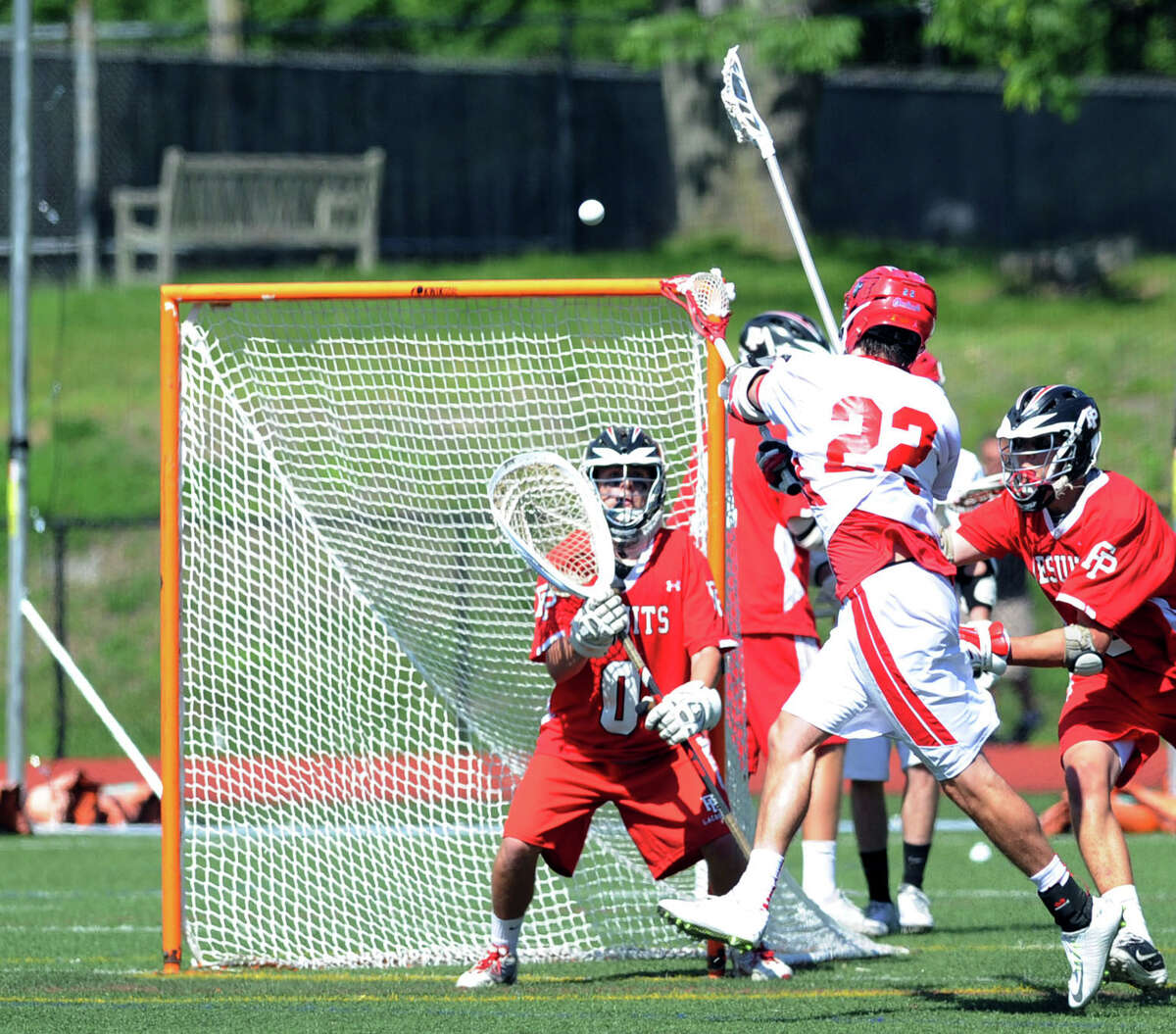 Ryan Flippin (#22) of Greenwich shoots as Farield Prep goalie John O'Connor (#0), left, defends during the Class L boys high school lacrosse quarterfinal match between Fairfield Prep and Greenwich High School at Greenwich, Saturday, June 7, 2014. Flippin did not score on the shot that O'Connor blocked but Greenwich went on to win the match, 9-8, advancing to the semi-final.