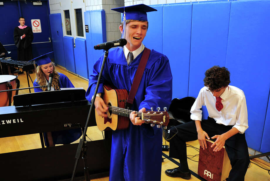 "Members of the High School Worship Band perform the Opening Song: ""Cornerstone,"" during the 31st Commencement Exercises of Christian Heritage School in Trumbull, Conn. on Saturday June 7, 2014. In the band from left to right is Dawn Williams, of Trumbull, on piano, Jeremiah Taubl, of New Haven, on guitar, and Justin Waters, on percussion. Photo: Christian Abraham / Connecticut Post"