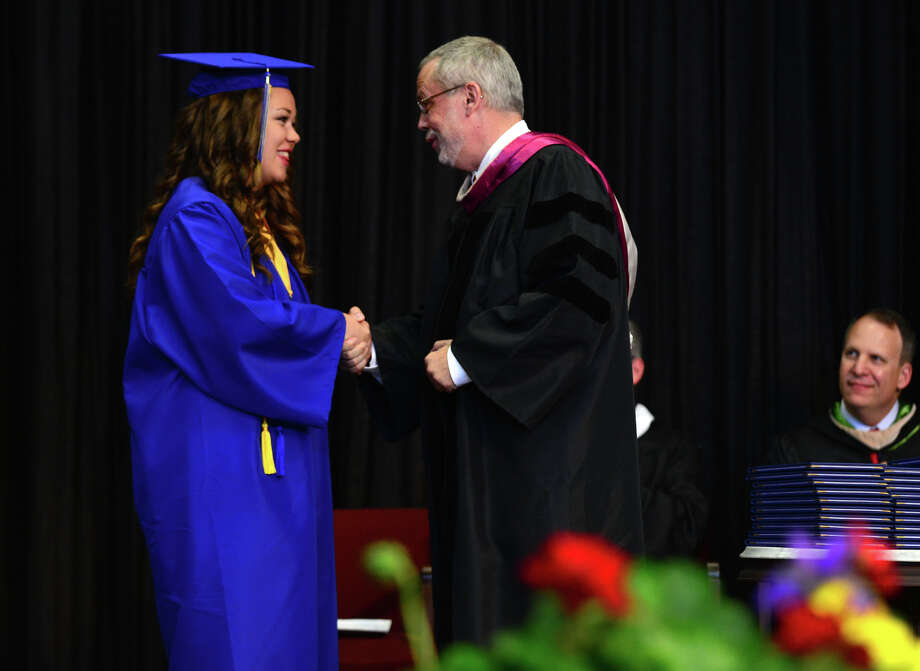 Graduate Julia Campbell, of Fairfield, shakes hands with Upper School Principal Dr. Boyd Chitwood, after being awarded the Faculty Key Award, during the 31st Commencement Exercises of Christian Heritage School in Trumbull, Conn. on Saturday June 7, 2014. Photo: Christian Abraham / Connecticut Post