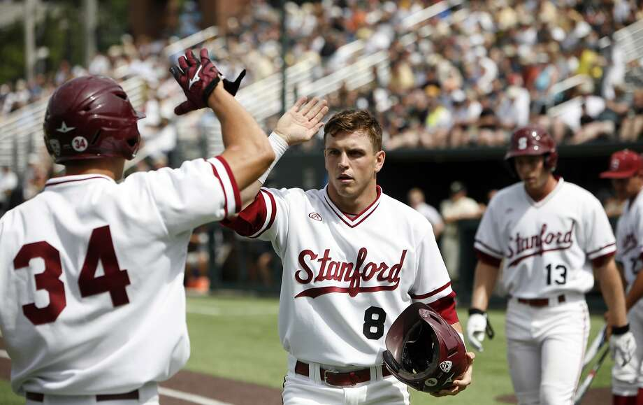 Zach Hoffpauir (8) was Stanford's biggest power threat in baseball this season, and was a starting safety in football. Photo: Wade Payne, Associated Press