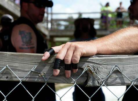 A competitor's fingers are reinforced with electrical tape Saturday morning. The 2014 Gator Rescue Tournament was held at Gator Country on Saturday. Photo taken Saturday 6/7/14 Jake Daniels/@JakeD_in_SETX Photo: Jake Daniels / ©2014 The Beaumont Enterprise/Jake Daniels