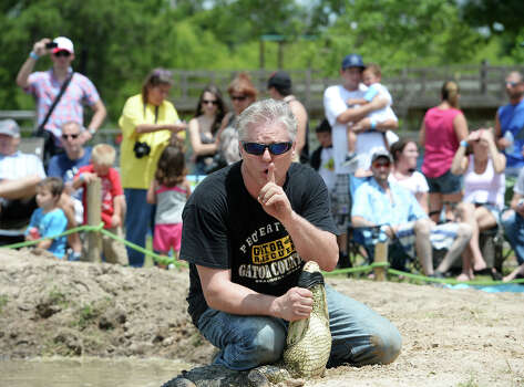 E.J. Hanhart motions to other alligator handlers as they prepare for the second event in Saturday's tournament. The 2014 Gator Rescue Tournament was held at Gator Country on Saturday. Photo taken Saturday 6/7/14 Jake Daniels/@JakeD_in_SETX Photo: Jake Daniels / ©2014 The Beaumont Enterprise/Jake Daniels
