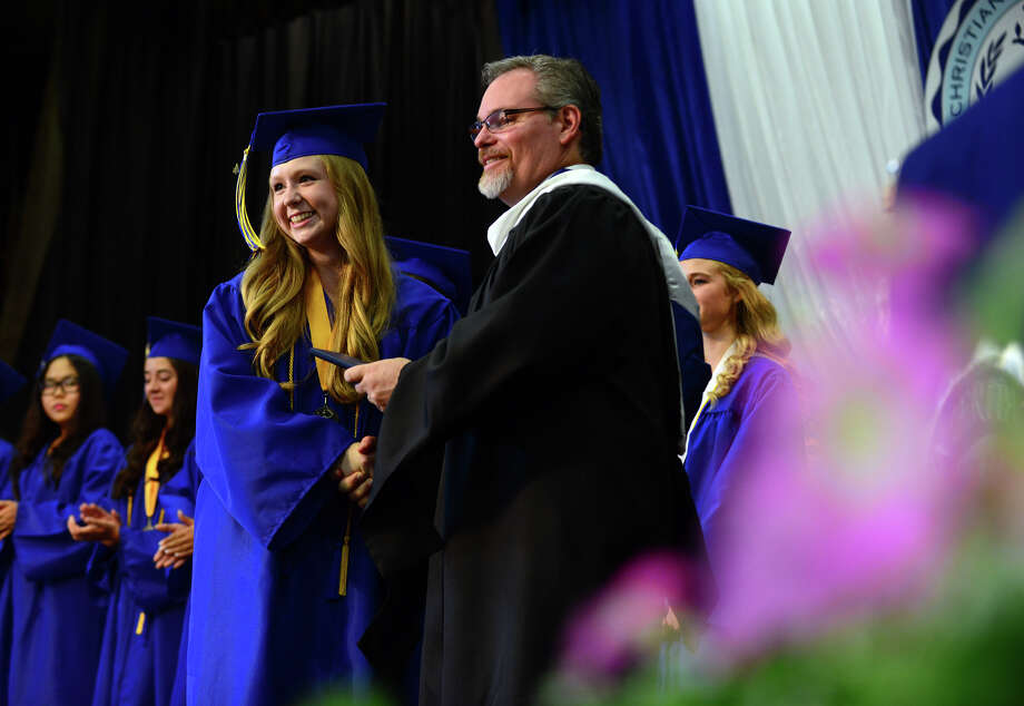 Graduate Skye Festog, of Greenwich, receives her diploma, during the 31st Commencement Exercises of Christian Heritage School in Trumbull, Conn. on Saturday June 7, 2014. Photo: Christian Abraham / Connecticut Post