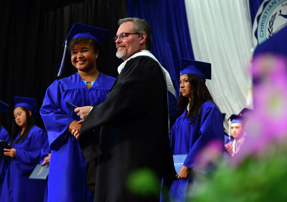 Graduate Amarah Guillory, of Shelton, receives her diploma, during the 31st Commencement Exercises of Christian Heritage School in Trumbull, Conn. on Saturday June 7, 2014. Photo: Christian Abraham / Connecticut Post