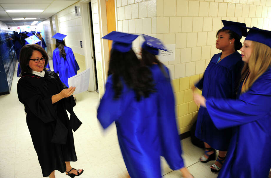 Teacher Robin Hannibal checks the order of graduates as they pass through the halls, before the start of the 31st Commencement Exercises of Christian Heritage School in Trumbull, Conn. on Saturday June 7, 2014. Photo: Christian Abraham / Connecticut Post