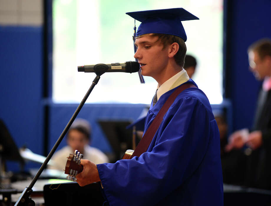 "Graduate Jeremiah Taubl, of New Haven, who is a member of the High School Worship Band performs the Opening Song: ""Cornerstone,"" during the 31st Commencement Exercises of Christian Heritage School in Trumbull, Conn. on Saturday June 7, 2014. Also performing in the band, but not pictured, is Dawn Williams, of Trumbull, on piano, and Justin Waters, on percussion. Photo: Christian Abraham / Connecticut Post"
