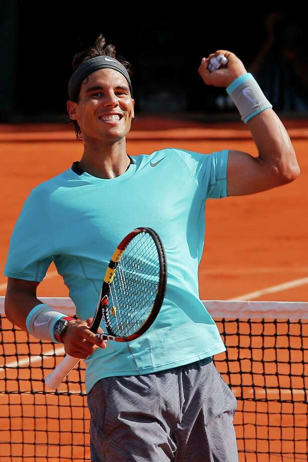 Spain's Rafael Nadal celebrates winning the semifinal match of the French Open tennis tournament against Britain's Andy Murray at the Roland Garros stadium, in Paris, France, Friday, June 6, 2014. Nadal won in three sets 6-3, 6-2, 6-1. (AP Photo/David Vincent) Photo: David Vincent, STR / AP
