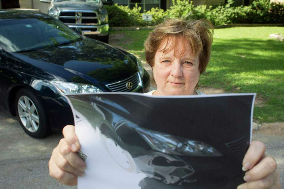 Rebecca Riley, 63, show the damage to her car after a hit-and-run crash. She got the fleeing car's tag number, but police did nothing in her case. Photo: Johnny Hanson / © 2014  Houston Chronicle