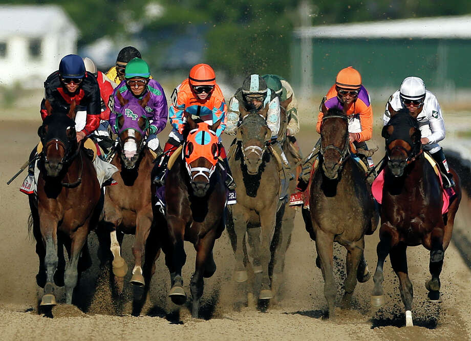 California Chrome, second from left,, runs in traffic behind Tonalist, left, and General A Rod (10) and as they head down the backstretch during the 146th running of the Belmont Stakes horse race at Belmont Park, Saturday, June 7, 2014, in Elmont, N.Y.  Tonalist went on to win the race, denying California Chrome the Triple Crown victory. (AP Photo/Jason DeCrow) Photo: Jason DeCrow, Associated Press / Associated Press