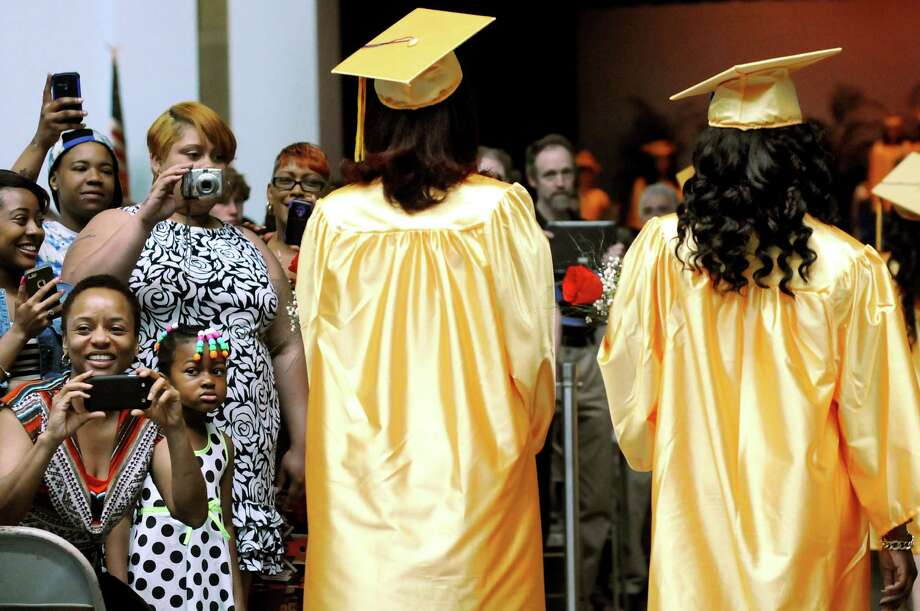 Family and friends snap pictures as graduates process into the auditorium for commencement exercises on Saturday, June 7, 2014, at Bishop Maginn High in Albany, N.Y. (Cindy Schultz / Times Union) Photo: Cindy Schultz / 00027203A