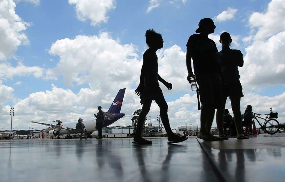 Visitors join the Houston Airport System to celebrate Bush Intercontinental Airport's 45th Birthday in the United Airlines Hangar on June 7, 2014, in Houston.  Keep going to see the planes that fly above Houston. Photo: Mayra Beltran, Houston Chronicle / © 2014 Houston Chronicle
