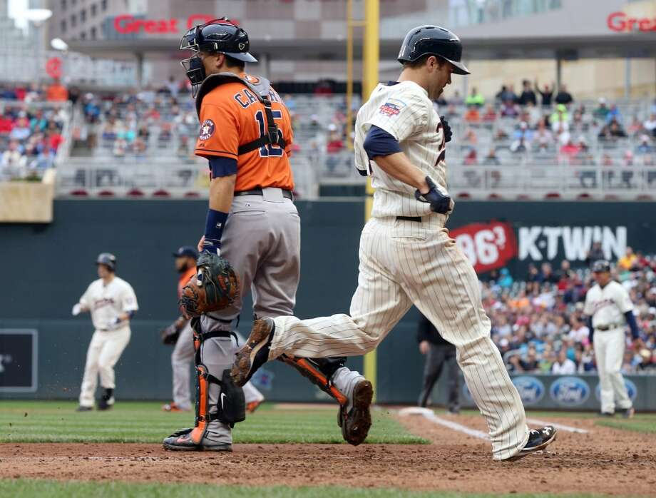 Brian Dozier, right, scores on a single by Josh Willingham. Photo: Jim Mone, Associated Press