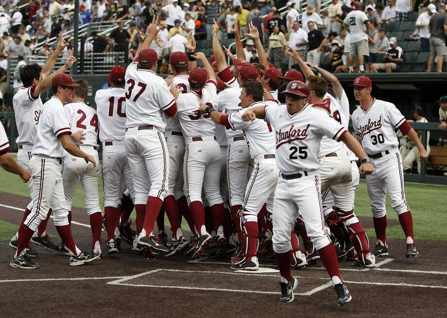 Stanford players happily celebrate a walk-off win on Wayne Taylor's homer. Photo: Wade Payne, Associated Press