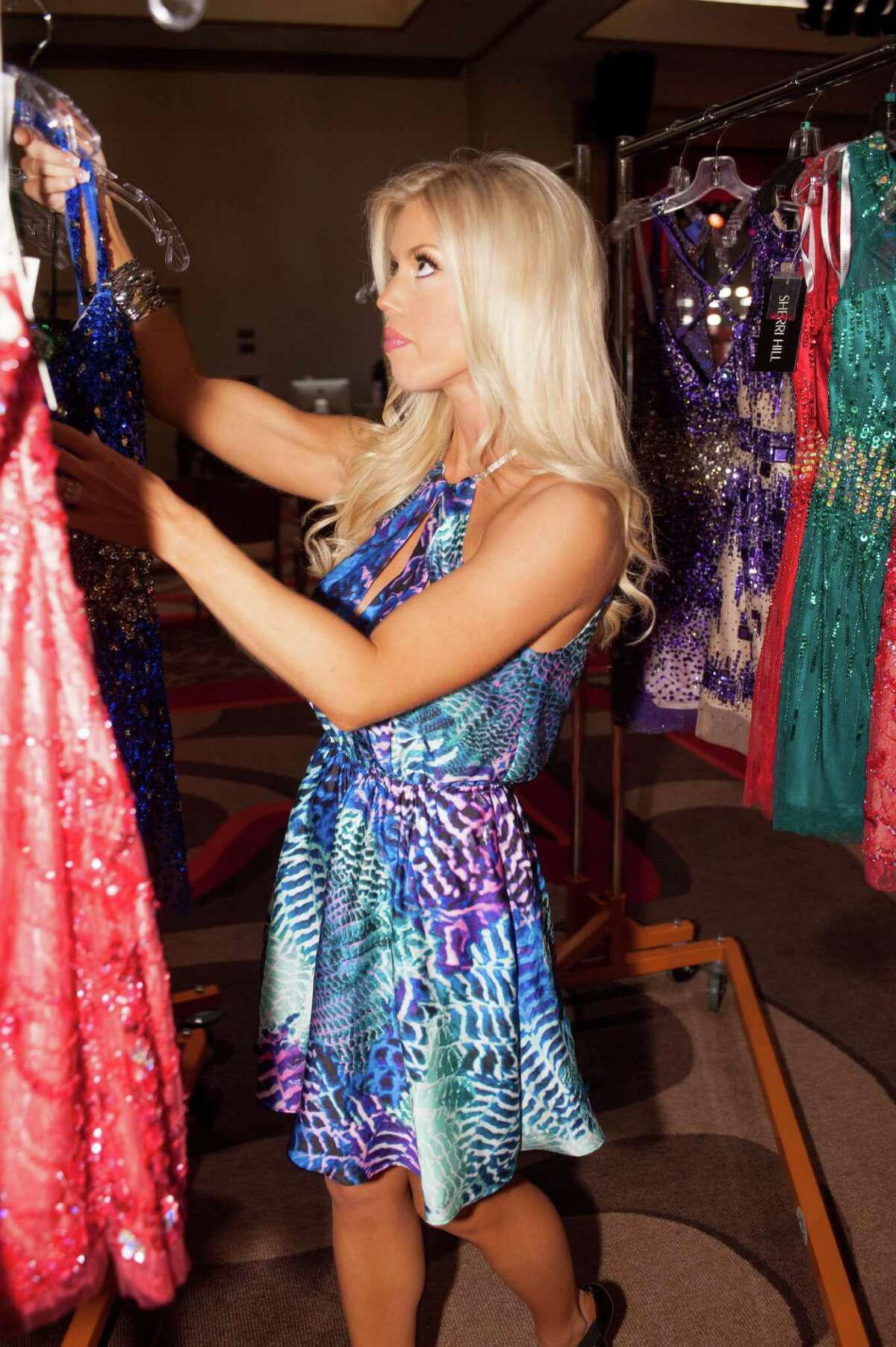 Allyson Rowe, Miss Washington USA 2014, selects a Sherri Hill Fashion design during Miss USA registration and fittings two weekends ago as the 51 contestants arrived in Baton Rouge, Louisiana. The pageant finals are Sunday night (NBC, 8 p.m., delayed three hours in the Pacific time zone).