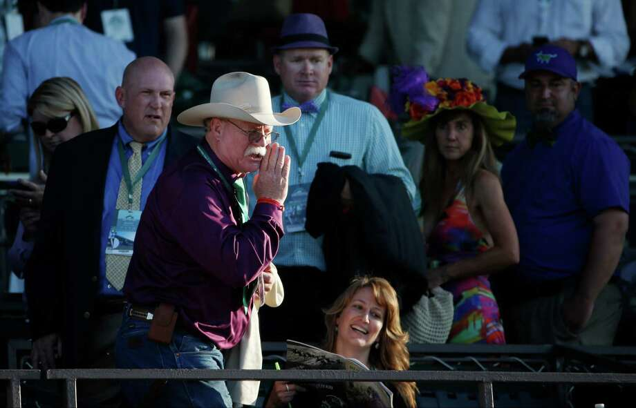 California Chrome co-owner Steve Coburn calls from the grandstand at Belmont Park after his horse finished fourth in the Belmont Stakes horse race, Saturday, June 7, 2014, in Elmont, N.Y. (AP Photo/Kathy Willens)  ORG XMIT: ELM171 Photo: Kathy Willens / AP