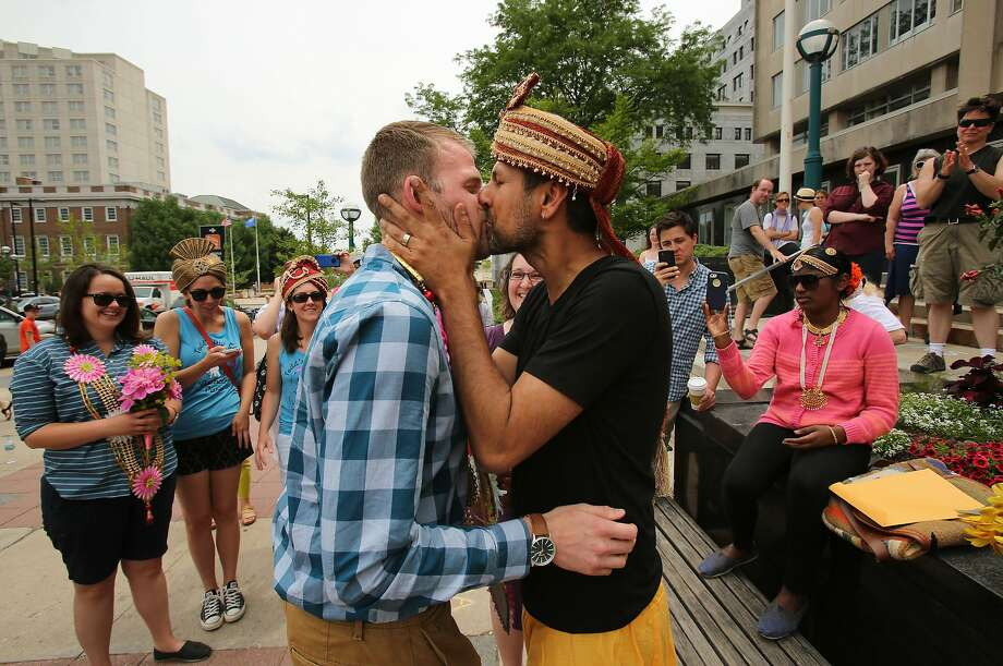 Todd Kinsman (left) and Ravi Manghnani kiss after their wedding in Madison, Wis., during what may be a brief window allowing same-sex marriage. Photo: Amber Arnold, Associated Press