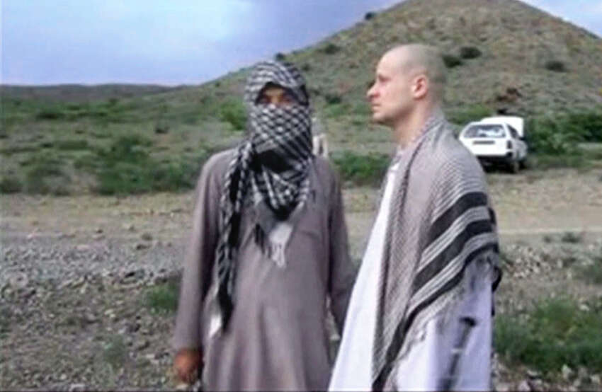 In a Voice of Jihad website image, Sgt. Bowe Bergdahl (right) stands with a Taliban member in eastern Afghanistan after his June 2009 capture. He was released May 31, 2014.