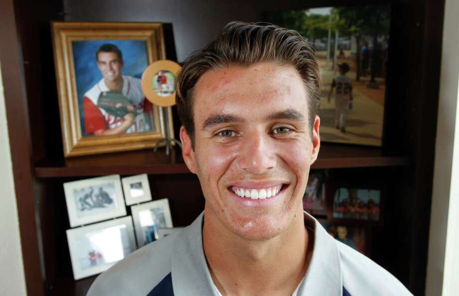 Cathedral Catholic High School pitcher Brady Aiken poses after he was selected by the Houston Astros as the first pick in the MLB draft on Thursday, June 5, 2014 in Encinitas, Calif. (AP Photo/U-T San Diego, Hayne Palmour IV)  NO SALES; COMMERCIAL INTERNET OUT Photo: Hayne Palmour IV, MBR / The U-T San Diego