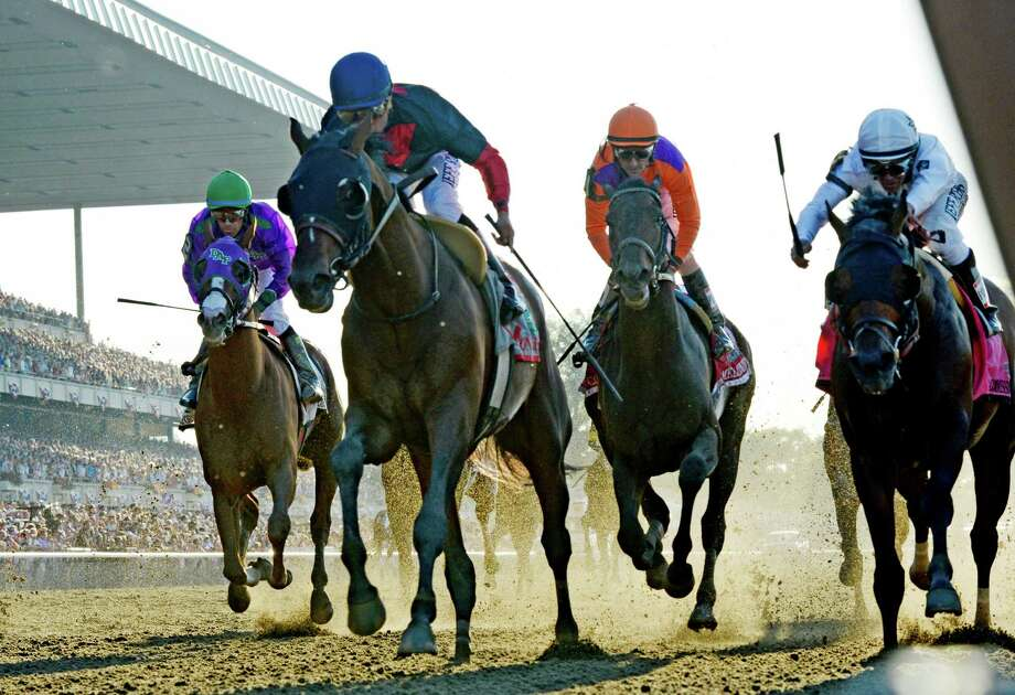 Tonalist with jockey Joel Rosario, second from left out duels the rest of the field to win the 146th Belmont Stakes Saturday evening June 7, 2014 at Belmont Park in Elmont, N.Y.    (Skip Dickstein / Times Union) Photo: SKIP DICKSTEIN