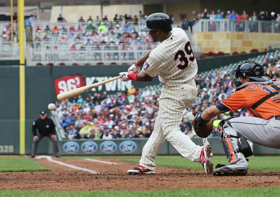 Minnesota's Danny Santana contributes to Astros starter Scott Feldman's misery with a two-run single in the second inning Saturday. Photo: Jim Mone, STF / AP