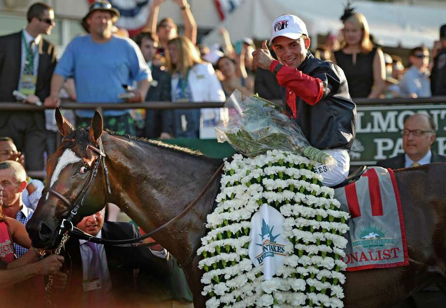 Jockey Joel Rosario sits atop Tonalist after winning the 146th Belmont Stakes Saturday evening June 7, 2014 at Belmont Park in Elmont, N.Y.    (Skip Dickstein / Times Union) Photo: SKIP DICKSTEIN