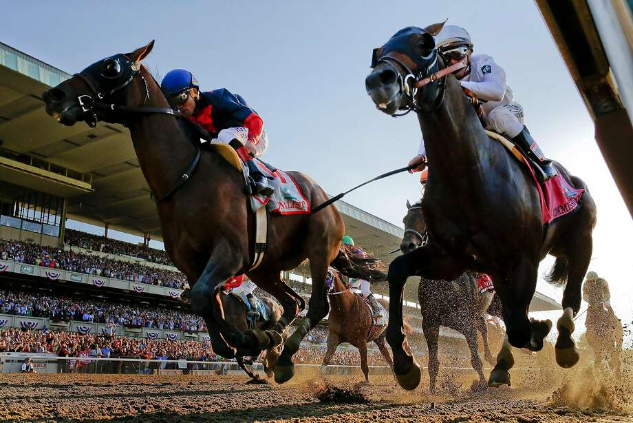 Tonalist, left, with Joel Rosario up edges out Commissioner with Javier Castellano up to win the 146th running of the Belmont Stakes horse race, Saturday, June 7, 2014, in Elmont, N.Y. Photo: Matt Slocum, Associated Press