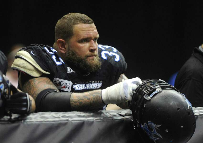 Mark Weivoda of the San Antonio Talons watches the action as his team takes on the Orlando Predators in Arena Football League action in the Alamodome on Saturday, June 7, 2014.