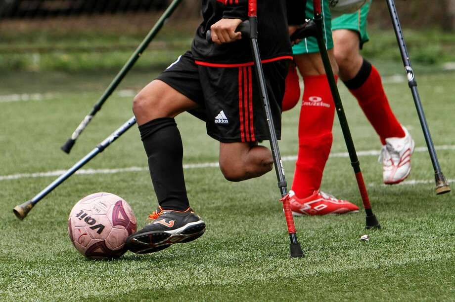 A player from the team Los Dragones, or the Dragons, controls the ball during a soccer game with Guerreros Aztecas, or Aztec Warriors, in Mexico City, Saturday, June 7, 2014. Before the start of each game players remove the artificial legs they use, playing only with crutches and kicking the ball with their remaining foot.  Photo: Marco Ugarte, Associated Press