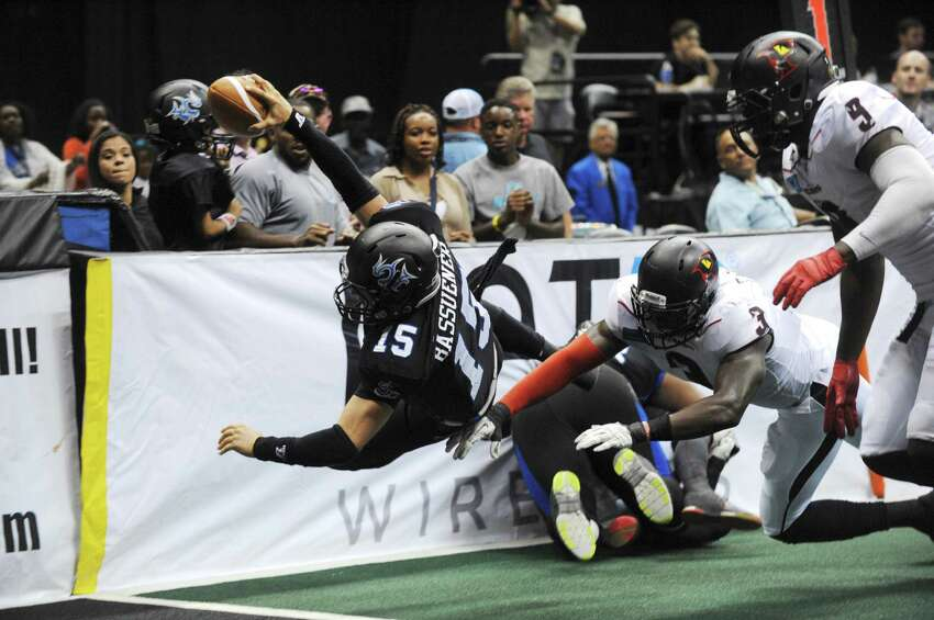 Matthew Bassuener of the San Antonio Talons dives for the goal line during Arena Football League action against the Orlando Predatorsin the Alamodome on Saturday, June 7, 2014. The play was called back because of a penalty.