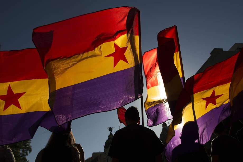 Protestors march as they wave Republican flags during a demonstration against the Spanish Monarchy and demanding a referendum in Madrid, Spain, Saturday, June 7, 2014. King Juan Carlos plans to abdicate and pave the way for his son, Crown Prince Felipe, to become the country's next king. The 76-year-old Juan Carlos oversaw his country's transition from dictatorship to democracy but has had repeated health problems in recent years, and his popularity dipped following royal scandals. Photo: Andres Kudacki, Associated Press