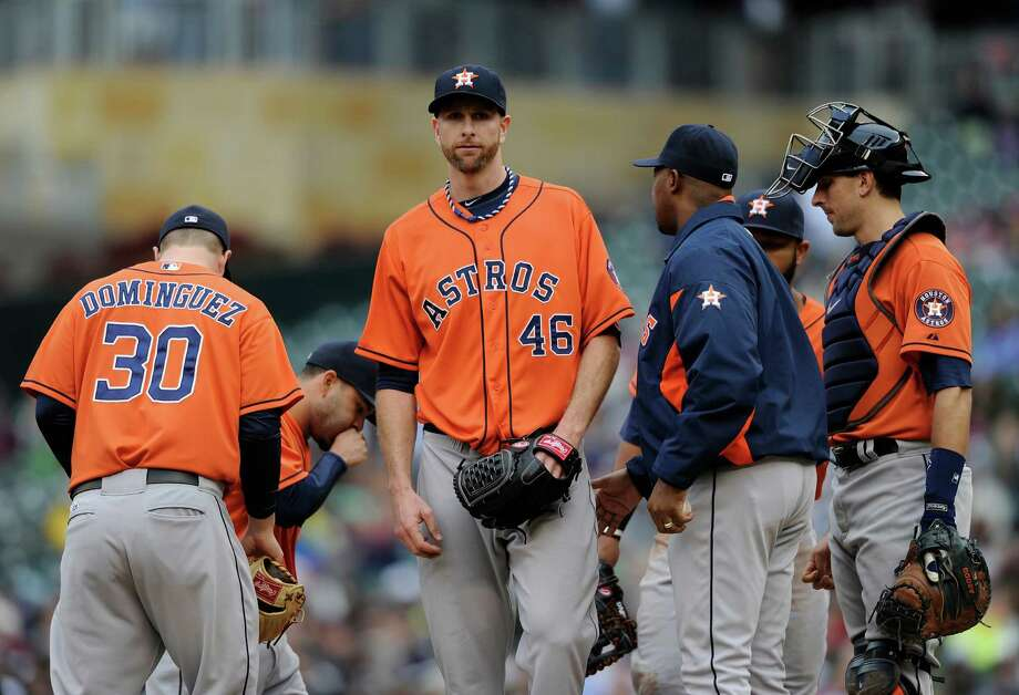 The look of dejection on the face of Scott Feldman (46) is one that's been several poor outings in the making for one of the Astros' most expensive players. Photo: Hannah Foslien, Stringer / 2014 Getty Images