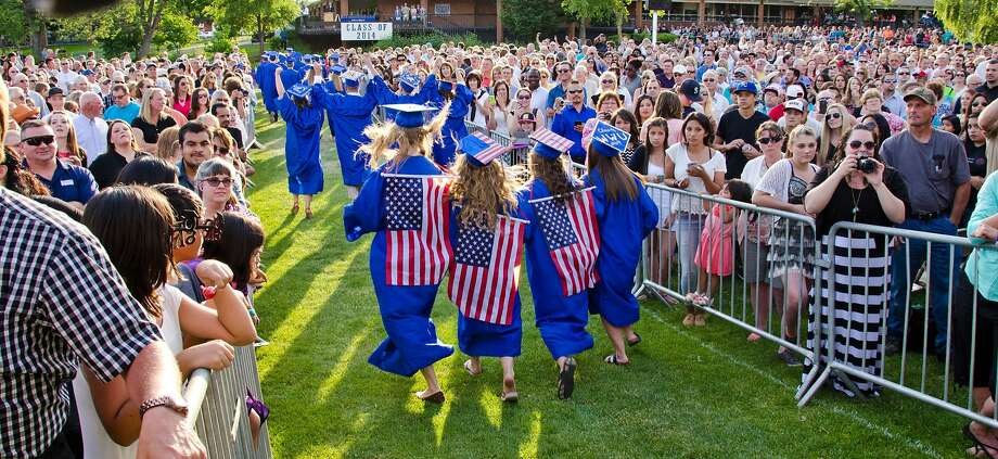 Chloe Wright, left, Ari Parker, Elissa Ropp and another classmate dance down the aisle during Walla Walla High School's graduation Friday evening, June 6, 2014, in Walla Walla, Wash.  Photo: Greg Lehman, Associated Press