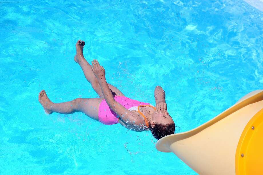 Haley Mummey, 10, plunges into the water at Lawton W. Shroyer Memorial swimming pool in Shamokin, Pa., Saturday, June 7, 2014.  Photo: Larry Deklinski, Associated Press