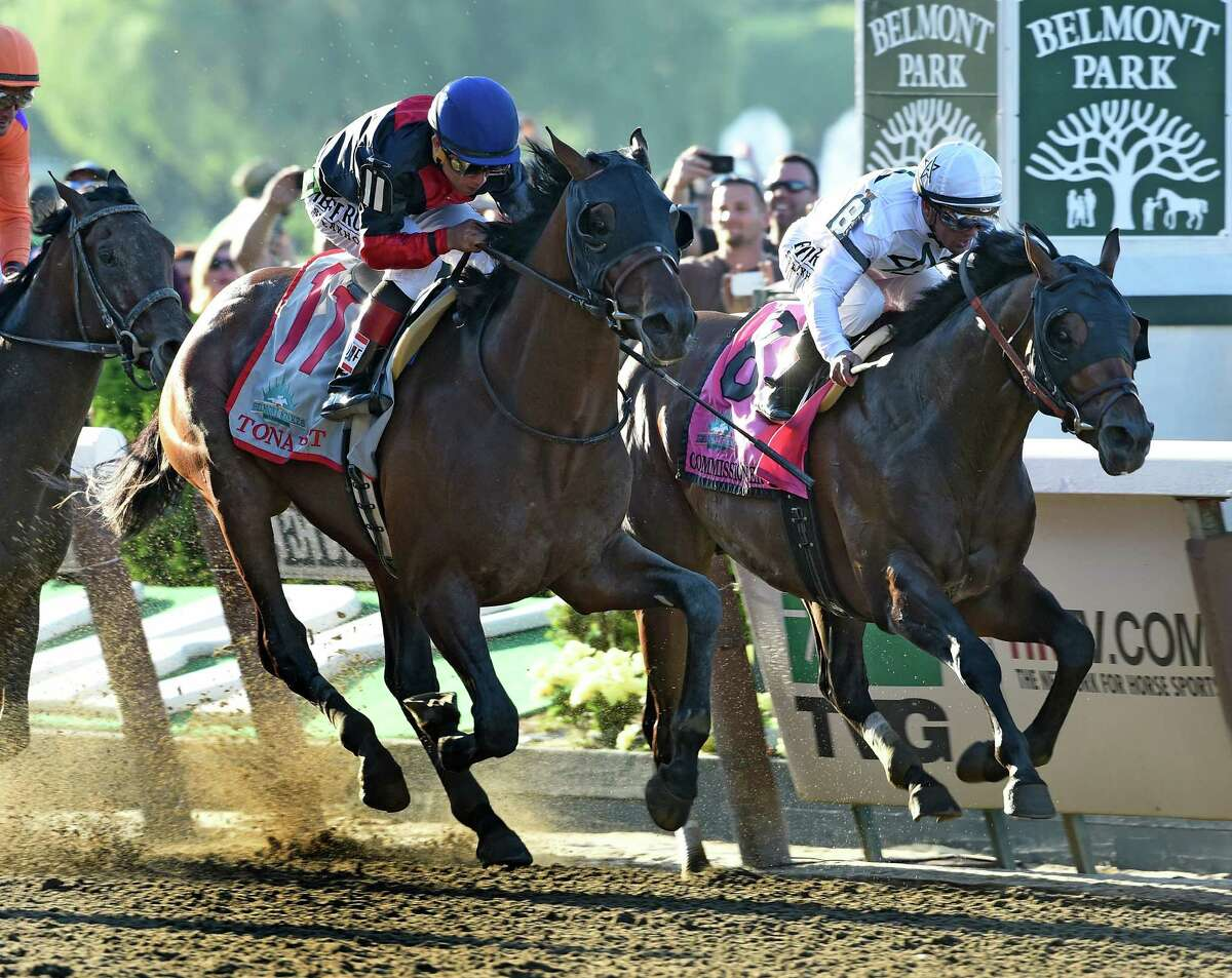 Tonalist with jockey Joel Rosario, left out duels Commissioner with jockey Javier Castellano, right to win the 146th Belmont Stakes Saturday evening June 7, 2014 at Belmont Park in Elmont, N.Y. (Skip Dickstein / Times Union)