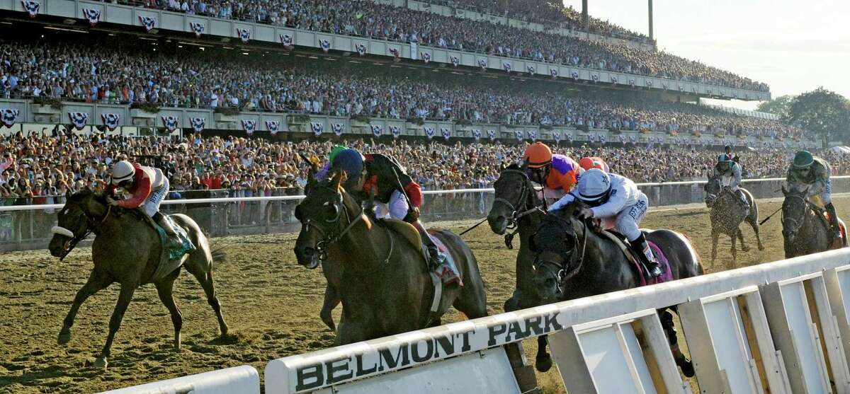 Tonalist with jockey Joel Rosario, center out duels the rest of the field to win the 146th Belmont Stakes Saturday evening June 7, 2014 at Belmont Park in Elmont, N.Y. (Skip Dickstein / Times Union)