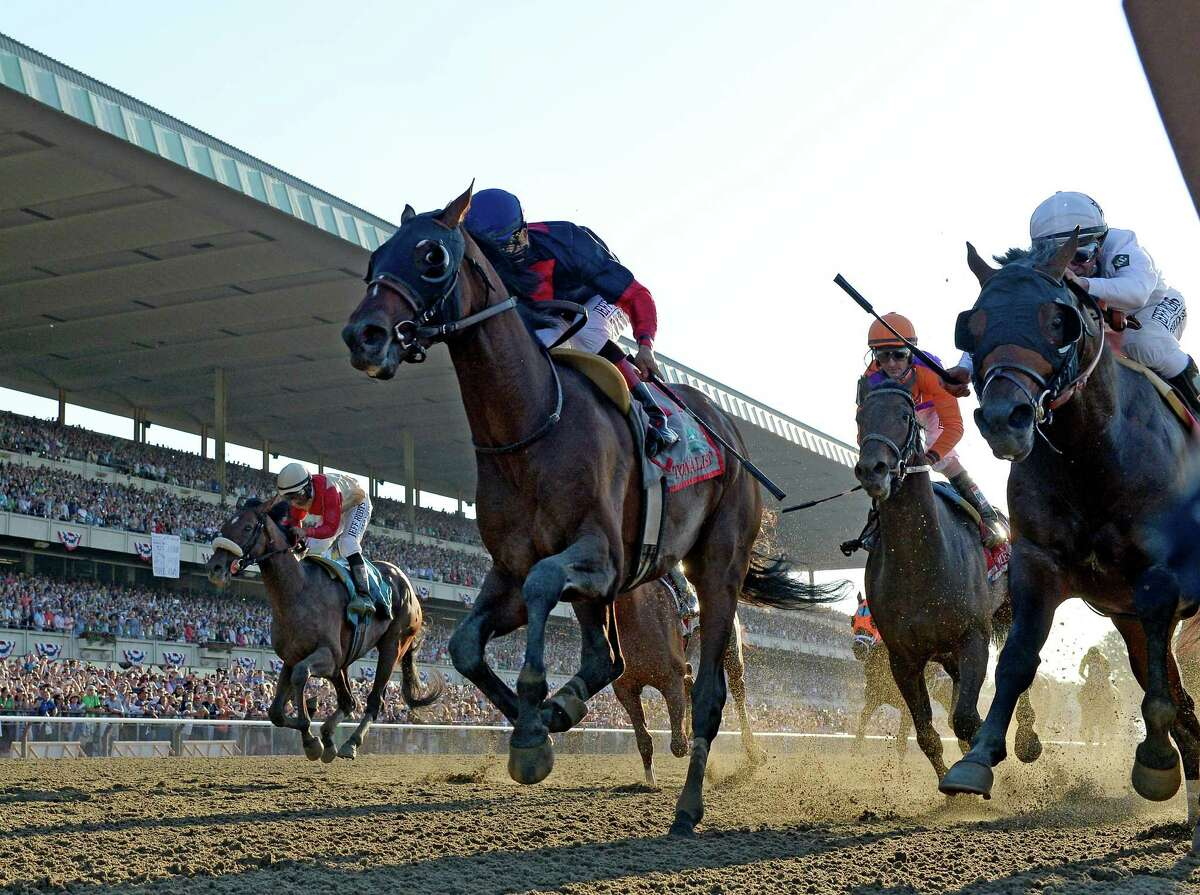 Tonalist with jockey Joel Rosario, left out duels the rest of the field to win the 146th Belmont Stakes Saturday evening June 7, 2014 at Belmont Park in Elmont, N.Y. (Skip Dickstein / Times Union)
