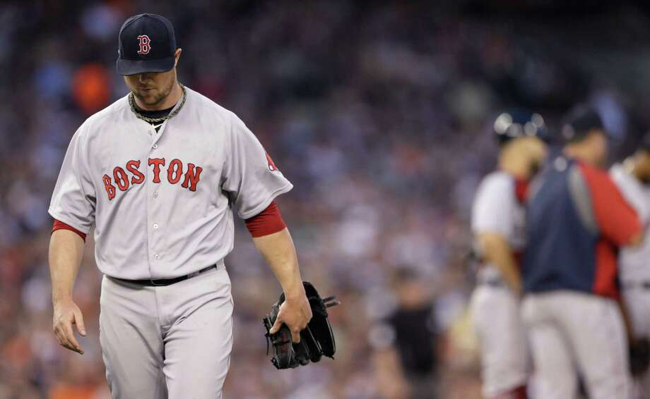 Boston Red Sox starting pitcher Jon Lester leaves after being pulled from the baseball game against the Detroit Tigers during the fifth inning in Detroit, Saturday, June 7, 2014. (AP Photo/Carlos Osorio)  ORG XMIT: MICO109 Photo: Carlos Osorio / AP