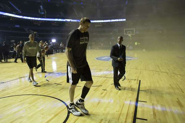 Matt Bonner and the Spurs staff evacuate Mexico City Arena in December when a fire postponed a game against Minnesota.